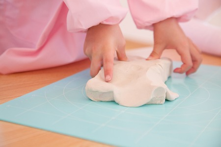 kindy: Hand of kindergarten girls play with clay