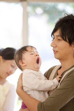 Nursery school boys to yawn is hug to nursery 写真素材