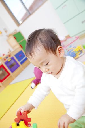 kindy: Nursery garden boys play with toys