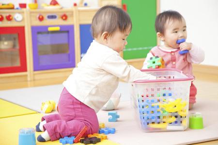 children play: Nursery school children play with toys