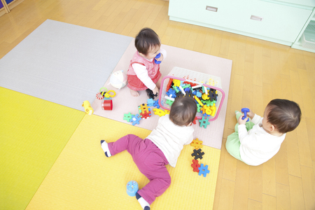 nursery school: Nursery school children play with toys