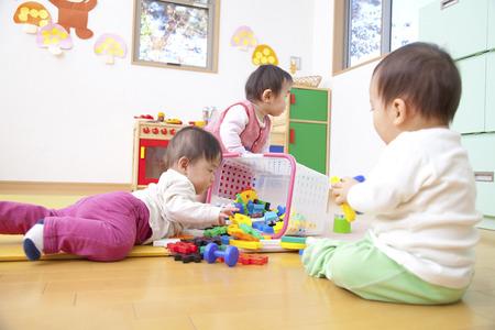 kindy: Nursery school children play with toys