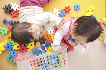 kindy: Nursery school children play with toys