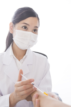 stabbing: Female doctor stabbing injections to patients