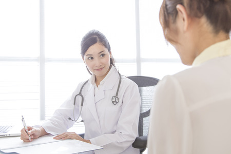 a medical examination: Female doctor to patient