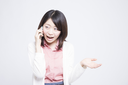 unstoppable: Woman in phone Stock Photo