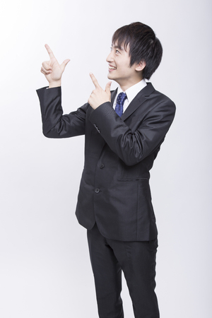 10s: Businessman pointing to