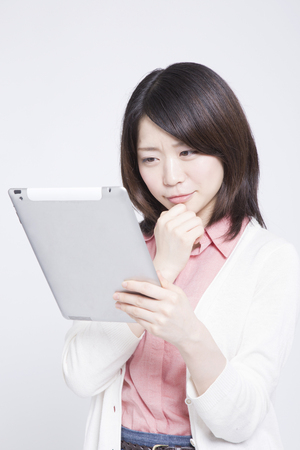 come up: Woman smiling with Tablet PC