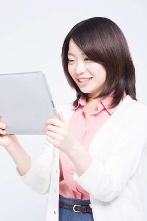 come up to: Woman smiling with Tablet PC