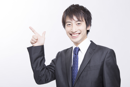 10 fingers: Businessman pointing to