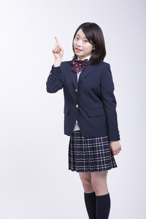 Pointing to high school girls photo