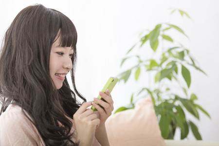 Women touch Smartphone