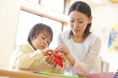 kindy: Fold the origami nursery and nursery garden boys Stock Photo