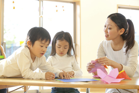 kindergartener: Fold the origami nursery and kindergarten Stock Photo