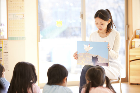 attentively: Rear View of kindergarten children to listen attentively to the picture-story show