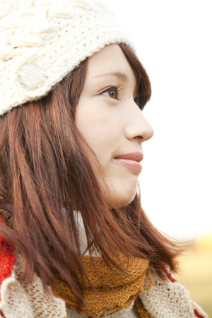 far away look: Woman staring into the distance Stock Photo