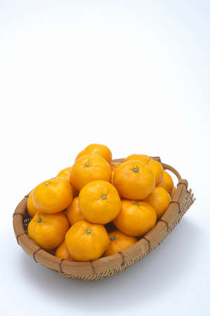 Oranges piled high in the basket Stock Photo