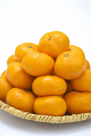abound: Oranges piled high in the basket Stock Photo