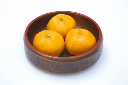 confectionery: Three oranges with confectionery bowl Stock Photo