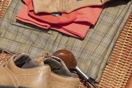 slacks: Golf clubs and golf wear Stock Photo