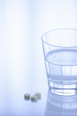 hygenic: Water tablets and cup of medicine