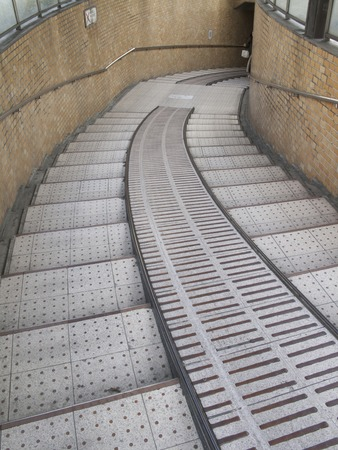a slope: Staircase with a slope that leads to the underpass Stock Photo