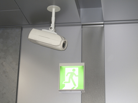 crime prevention: Sign of security cameras and emergency exit Stock Photo
