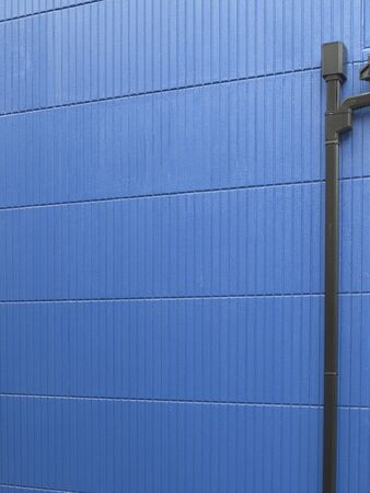 rain japan: Blue wall of painted houses