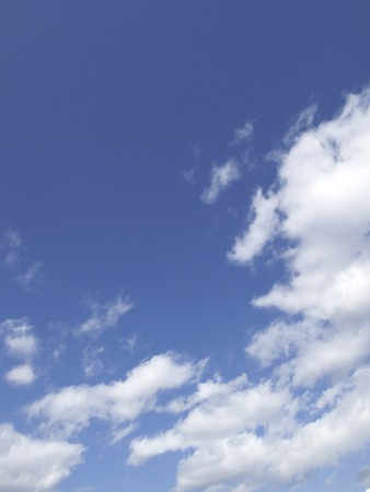 exhilarating: Blue sky and white clouds Stock Photo