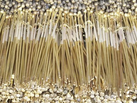tongs: Gold tongs Stock Photo