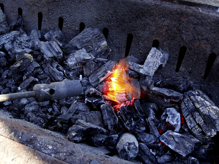 gas burner: We want to ignite the charcoal with a gas burner
