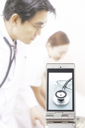 utiles de aseo personal: Stethoscope that goes to the doctor and the nurse and the mobile screen