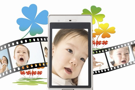 four people: Baby pictures on the mobile screen