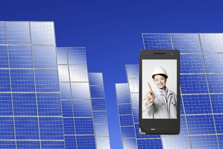 Work on the mobile screen wearing women clad with solar panels photo