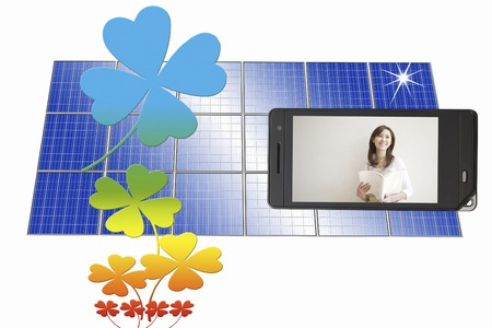 Women in solar panels and mobile screen photo