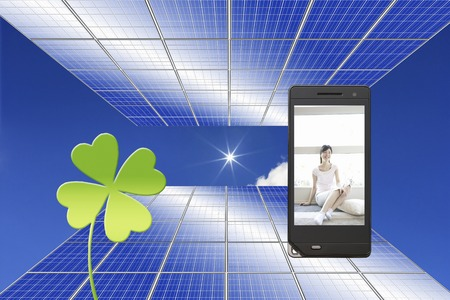 Woman in solar panels and mobile screen photo