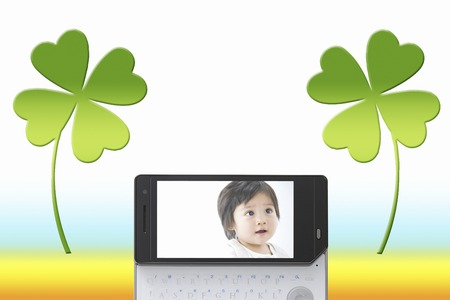 Baby pictures on the mobile screen photo