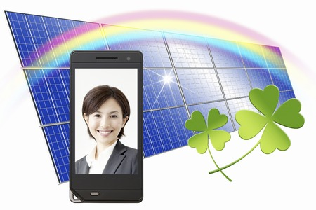 OL smile reflected on the mobile screen and solar panels photo