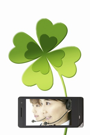 rythm: Clover of operators and YOTSUBA that moves to the mobile screen Stock Photo