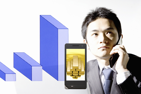 net worth: Businessman and mobile electric screen captured area bullion Stock Photo