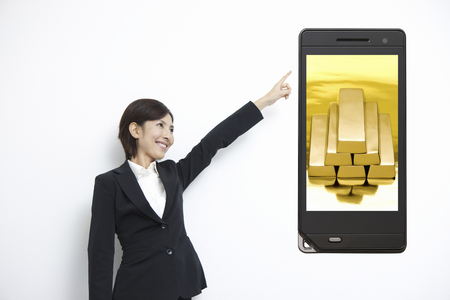 ol: Gold bullion to OL and mobile screen Stock Photo