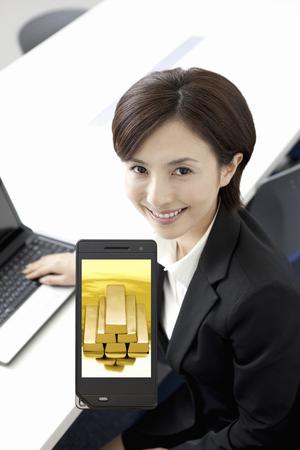 lingote oro: El oro en lingotes de OL y la pantalla del m�vil