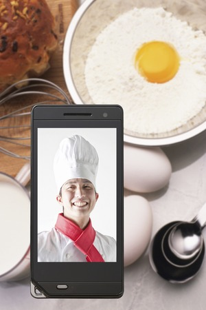 Chefs on ingredients and mobile screen photo