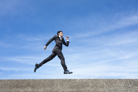 emptiness: Businessman jumping
