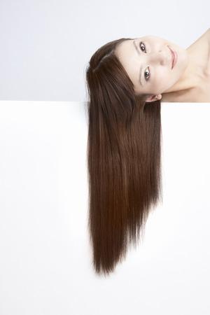 woman washing face: Straight hair female Stock Photo