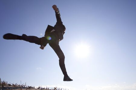straddle: Businessman jumping