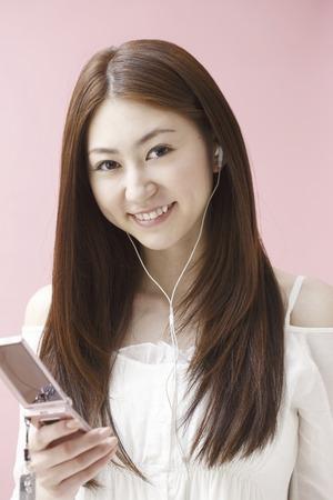earphone: Woman to the earphone Stock Photo