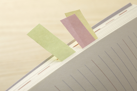 postit note: Put a sticky note schedule book Stock Photo