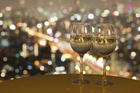 radiancy: Night view of the city reflected in the glass of wine