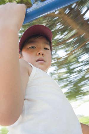 playground equipment: Boy playing in playground equipment